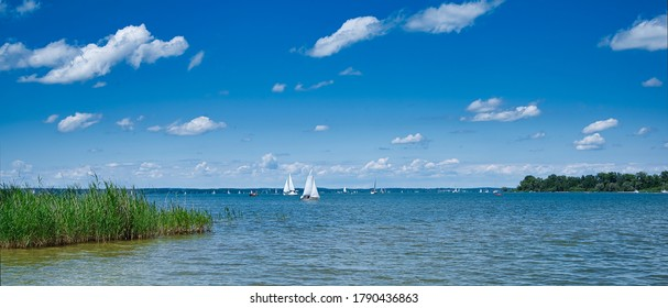 panorama of the Chiemsee in Bavaria with a lot of small sailing boats