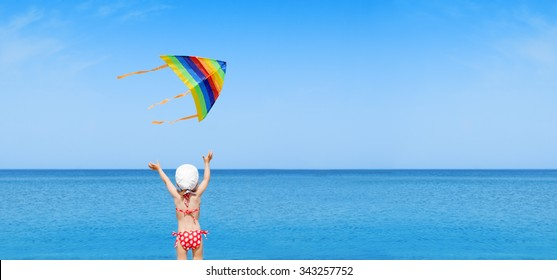 panorama child play flying kite on beach