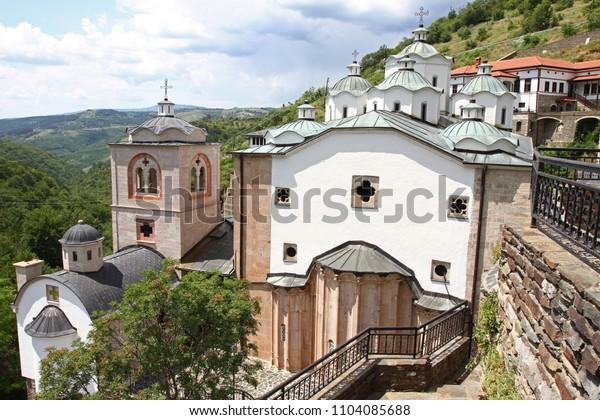 Panorama to church of Virgin Mary and medieval building in Monastery Saint Joachim of Osogovo, Kriva Palanka, Republic of Macedonia. The domes of a church. Christianity. East Orthodox Osogovo monaster
