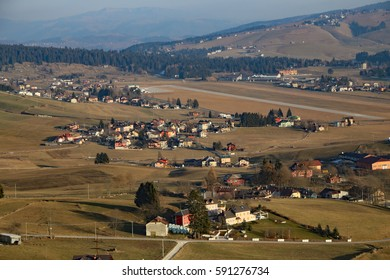 panorama of the city of Asiago in the province of Vicenza in northern Italy and the runway of the city airport landing
