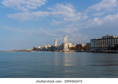 Panorama of the city of Bari, the capital of Puglia in southern Italy, with a view of the sea, buildings and the Ferris wheel.