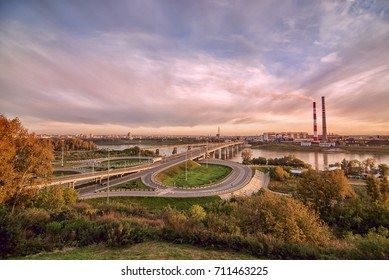 panorama of city center Kemerovo on river Tom with two bridges under colorful cloudy sky Siberia, Russia
