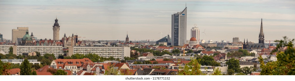 Panorama of the city of Leipzig with tall buildings, town hall and churches