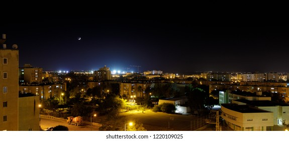 Panorama of city neighborhood in Beer Sheba at evening with new moon