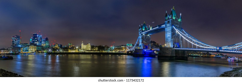 Panorama of the city skyline at sunset with London Tower Bridge and Tower of London on Thames river in London England