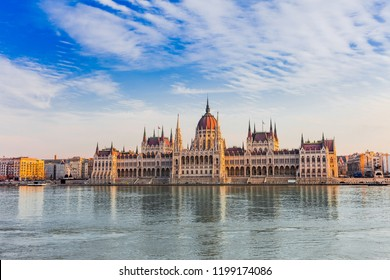 Panorama cityscape of famous tourist destination Budapest with Danube, parliament and bridges. Travel illuminated landscape in Hungary, Europe.