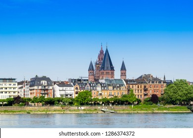 Panorama cityscape of Mainz with cathedral and Rhine at blue sky