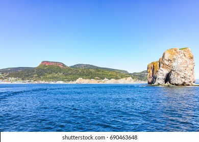 Panorama cityscape of Perce in Gaspe Peninsula, Quebec, Gaspesie region with cliffs in morning and Rocher Perce side view