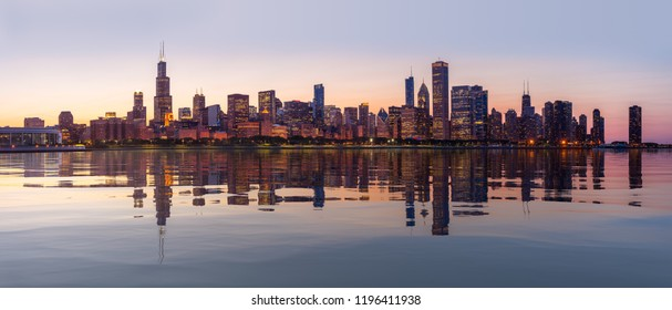Panorama of cityscape skyline of Chicago from the old observatory at sunset and reflected in artificial water surface
