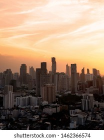 Panorama of cityscape with sunset over the building and blue sky at bangkok ,Thailand. Vertical view of the tall building in capital with twilight .Shot using Panorama technique.