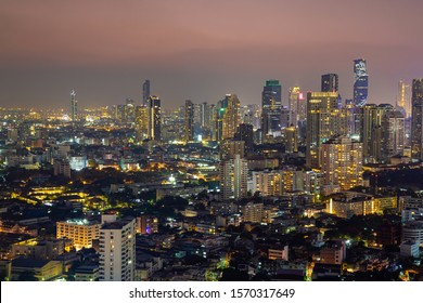 Panorama of cityscape with sunset over the building and blue sky at bangkok ,Thailand. View of the tall building in capital with twilight .Shot using Panorama technique.
