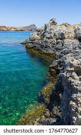Panorama of clear blue water, in Lindos in Rhodes island, famous for historic landmarks and beautiful beaches, in Greece.