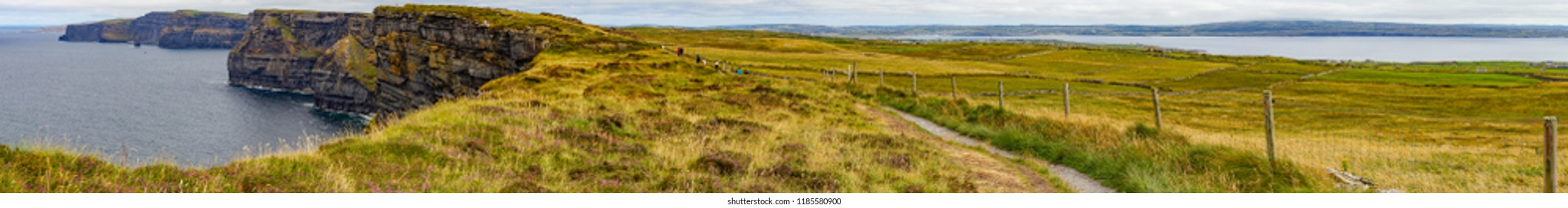 Panorama of Cliff of Moher with farm field and trail, Doolin, Clare, Ireland