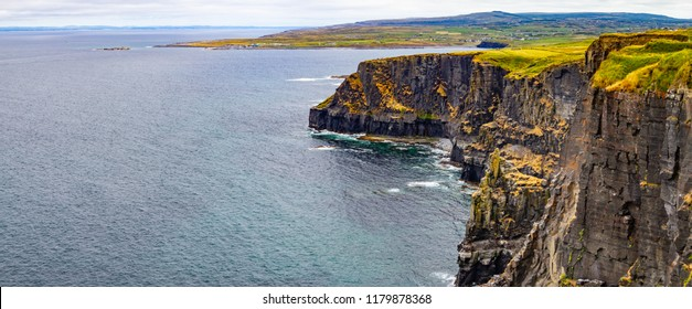 Panorama of Cliffs of Moher with Doolin village and farm fields in background, Clare, Ireland