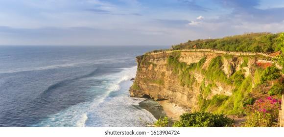 Panorama of the cliffs and ocean at the Ulu Watu temple in Bali, Indonesia