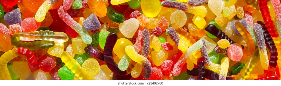 panorama close up a background from colorful sweets of sugar candies and marmalade. assortment candies panoramic view