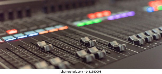 Panorama close-up buttons equipment for sound mixer control. Mixer for musician DJ and sound engineers. Mixing DJ remote with colorful neon light. Night club, nightlife concept