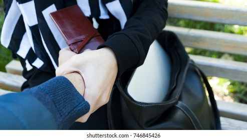The panorama of close-up of woman hand stops thief outdoors