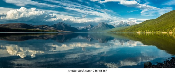 Panorama with Clouds reflected in Lake McDonald in Glacier National Park, Montana, USA