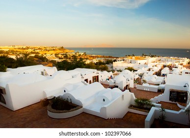 Panorama of the coast of Egypt to the white city (Sharm el Sheikh) in a morning sunrise