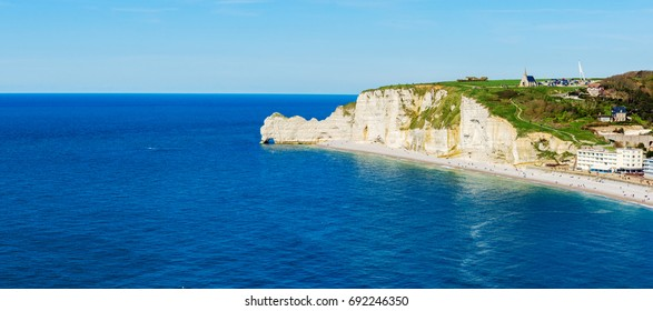 Panorama of coastline and chalk cliffs of Etretat, Normandy, France, Europe