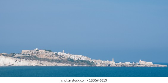 Panorama of the coastline of the Gargano Peninsula in Puglia, southern Italy, with the town of Vieste on the horizon. Photographed on a clear day in late summer.