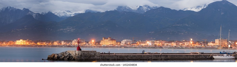 Panorama of the coastline of Versilia, Tuscany, surrounded by the snowy Apuan Alps, famous for the extraction of marble