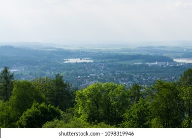 The panorama of Coburg roofs behind the trees. Bavaria, Germany