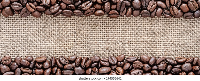 Panorama of coffee beans on sackcloth