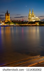 Panorama Cologne Cathedral, Great St. Martin's Church at night during the blue hour on the Rhine.