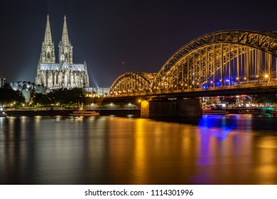 Panorama Cologne Cathedral and Hohenzollern Bridge at night during the blue hour on the Rhine.