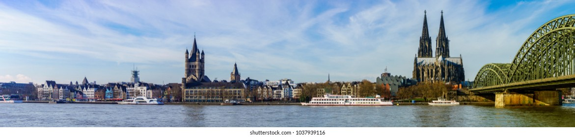 Panorama of Cologne with Great St. Martin Church, Cologne Cathedral, Hohenzollern Bridge and the Rhine river, Germany