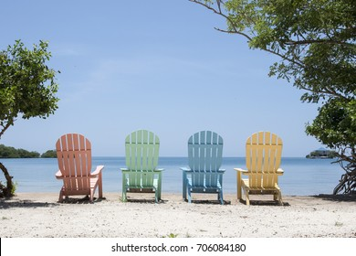 Panorama of colorful lounge chairs at a tropical paradise beach in Cartagena, Colombia