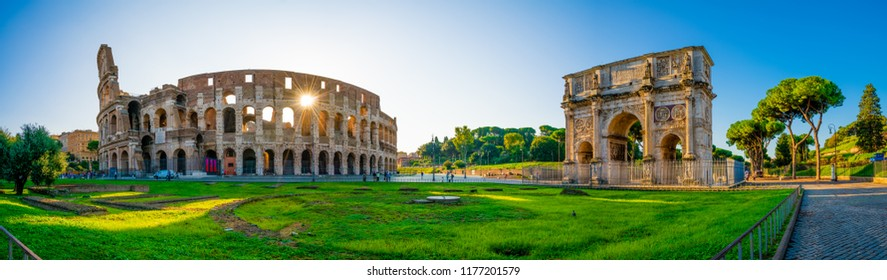 Panorama of Colosseum and Constantine arch at sunrise in Rome, Italy