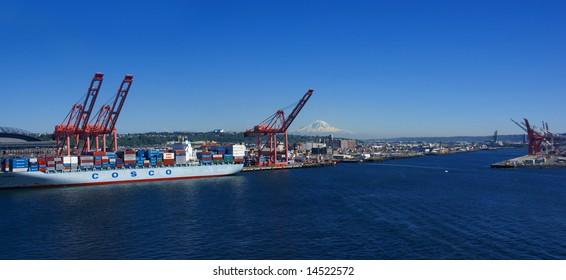 Panorama - Container ship and dockyard cranes;  Mt. Rainier in backgroundPuget Sound, Pacific Northwest