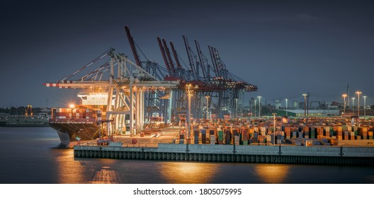 Panorama of a container terminal in the port of Hamburg at night
