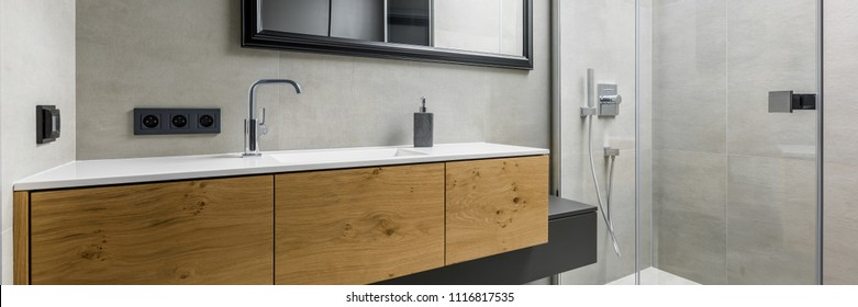 Panorama of contemporary gray bathroom with countertop basin, shower and mirror