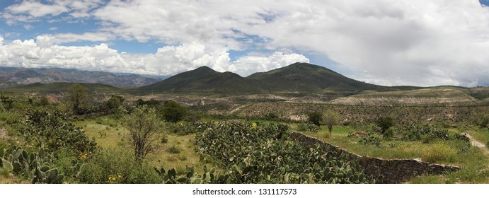 Panorama of countryside landscape and indigenous Wari wall in Peru. This photo is made attaching together various photos.