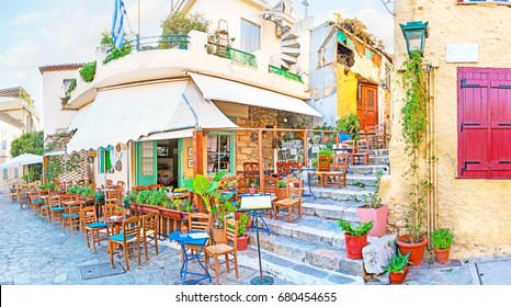Panorama of cozy outdoor cafe in Plaka, the best place to walk and relax with a cup of Greek coffee, Athens, Greece.