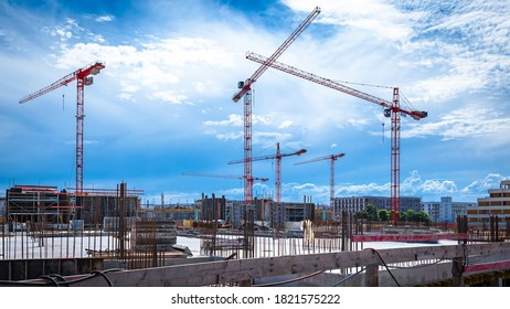 Panorama of Cranes on a Large Construction Site with Dramatic Sky
