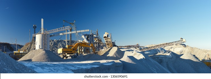 Panorama of the crushing plant on the background of the blue sky. Mining industry.