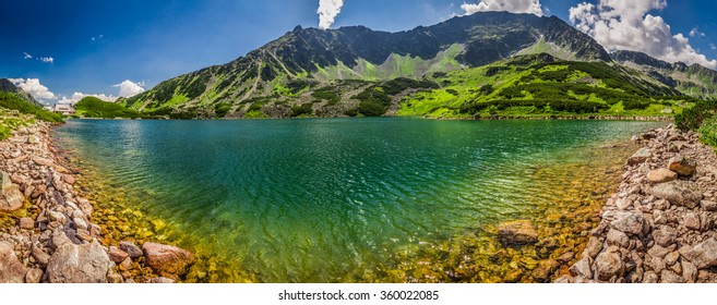 Panorama of crystal clear pond in the Tatra Mountains
