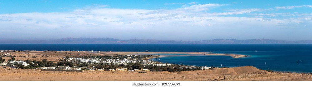 Panorama of Dahab city seaside - egyptian resort of Sinai Peninsula for your web header about travel to Egypt. Horizontal background for your billboard - summer holidays on The Red Sea.