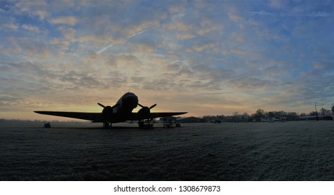 panorama of Dakota DC-3 warbird with colourful sunrise