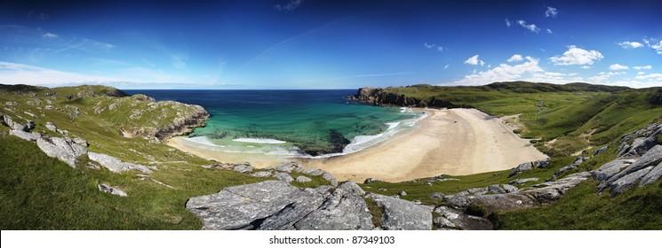 Panorama of Dalmore beach on Lewis, Scotland in summer sun