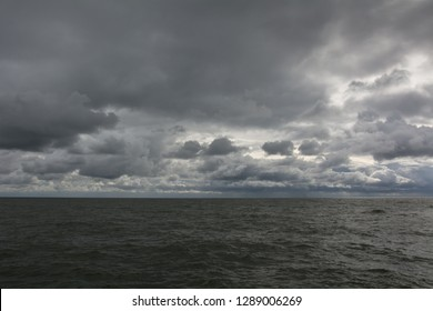 Panorama of dark sky and sea waves
