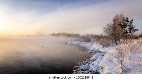 panorama of dawn on the Reftinsky reservoir in winter, Russia Ural, February