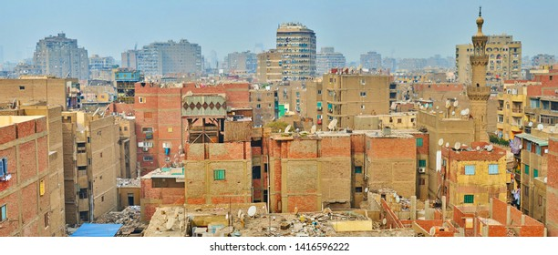 Panorama of dense shabby high-rises in overpopulated Al-Sayeda Zeinab district of Cairo with garbage and numerous satellite dishes on the rooftops, Egypt