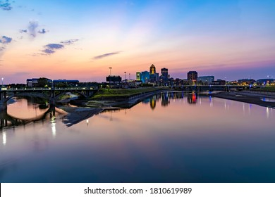Panorama of Des Moines Skyline at Sunset with Reflections in the Des Moines River