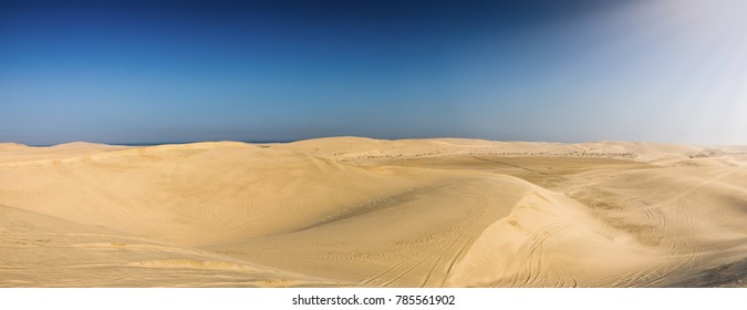 Panorama of the desert of Qatar leading to the inland sea